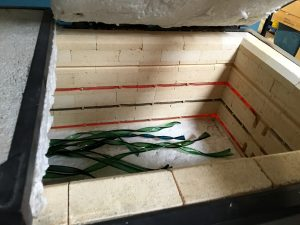 Glass ribbon pieces cooling at a standard rate in the annealer